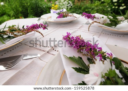 Outdoor table setting for the celebration - stock photo