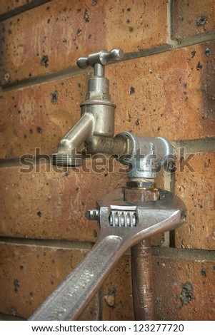 Outdoor Tap Repair - stock photo
