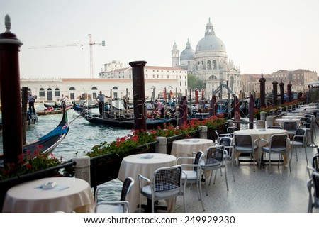 Outdoor terrace cafe overlooking the Grand canal - stock photo