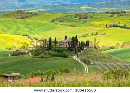 Outdoor Tuscan Farmhouse and hills landscape. Horizontal shot - stock photo