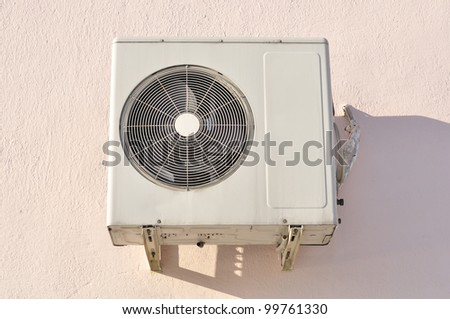 Outdoor Unit of Air Conditioner on the Wall - stock photo