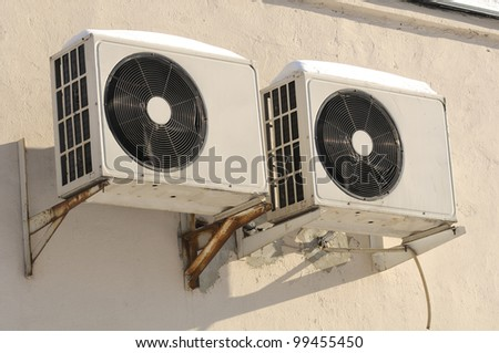 Outdoor Units of Air Conditioner on the Wall - stock photo