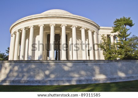 Outdoor view of Jefferson Memorial in Washington DC with clear blue sky in background. - stock photo