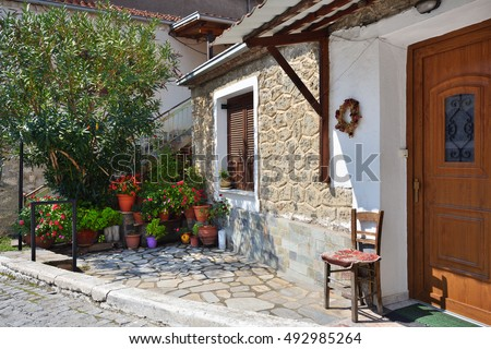 Outdoor view of the cute traditional stone building in greek village on sunny day, Kastraki, Meteora, Greece