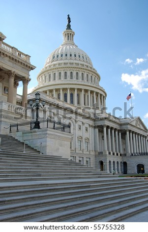 Outdoor view of US Capitol in Washington DC with beautiful blue sky in background - stock photo