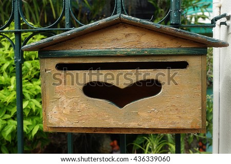 Outdoor vintage wood post box - stock photo