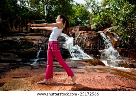 outdoor waterfall young woman stretching her body