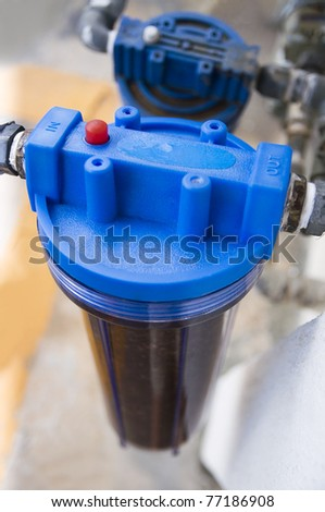 Outdoor weather resistance water filter in shallow depth of field. - stock photo