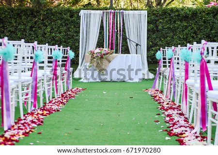 Outdoor wedding ceremony decoration setup path stock photo edit now outdoor wedding ceremony decoration setup path with petals chairs decorated with colorful ribbons junglespirit Image collections