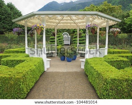 Outdoor wedding gazebo in the garden in the mountain setting - stock photo