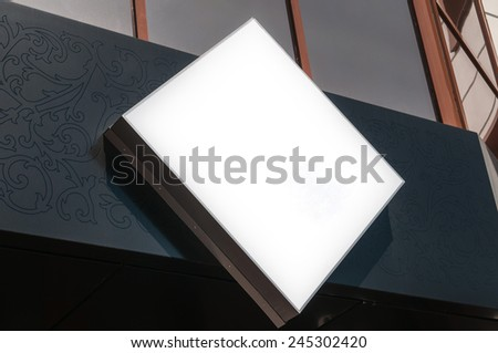 outdoor white sign above the shop - stock photo