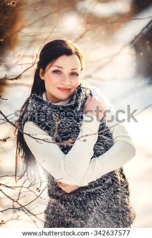 Outdoor winter portrait of young attractive woman.