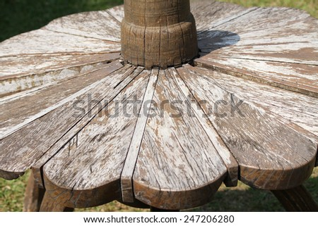 Outdoor wooden table and chairs in yard.