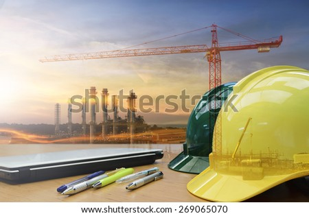 Outdoor work Workers in oil refineries. Safety helmets must be worn for safety. - stock photo