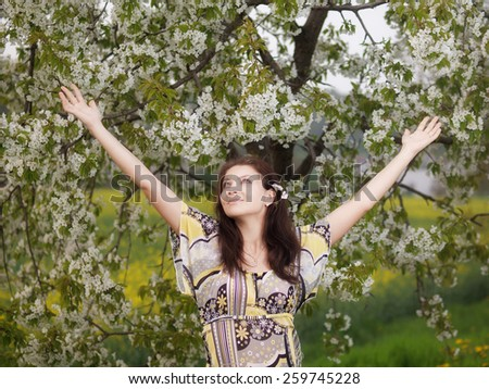 Outdoor young woman during springtime - stock photo