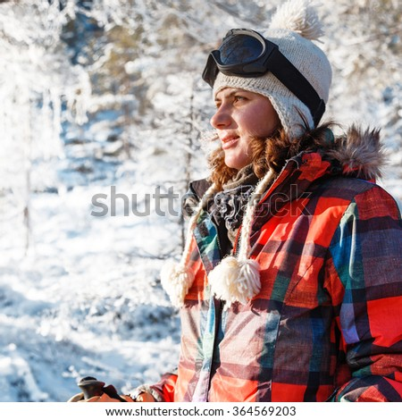 Outdoor young woman portrait at ski equipment