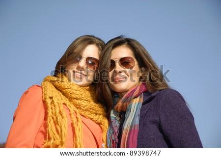 Outdoors autumn young women enjoying a blue sky day. - stock photo