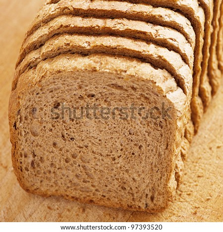 outdoors cutting board cut rye bread, on background wooden table - stock photo