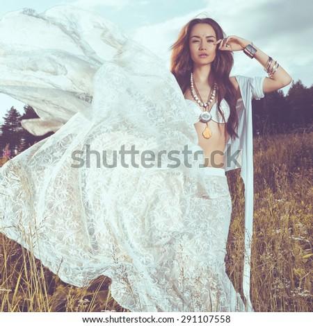 Outdoors fashion  photo of beautiful bohemian lady - stock photo