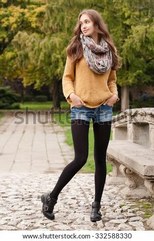 Outdoors portrait of a brunette autumn fashion beauty. - stock photo