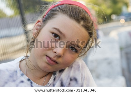 Outdoors portrait of a little girl - stock photo