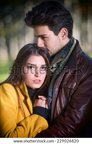 Outdoors portrait of a romantic young couple - stock photo