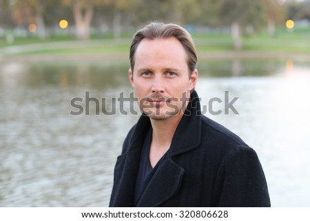 Outdoors portrait of a young man - stock photo