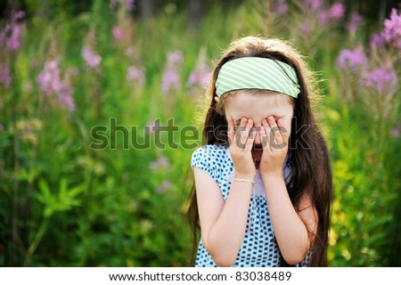 Outdoors portrait of adorable confused child girl - stock photo