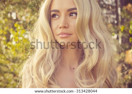 Outdoors portrait of beautiful romantic lady with magnificent healthy hair - stock photo