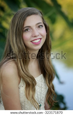 Outdoors portrait of beautiful young brunette girl  - stock photo