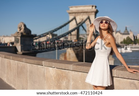 Outdoors portrait of elegant stylish young tourist woman.
