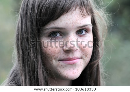 outdoors portrait of freckled teenage girl