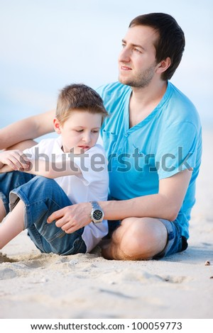 Outdoors portrait of happy father and son