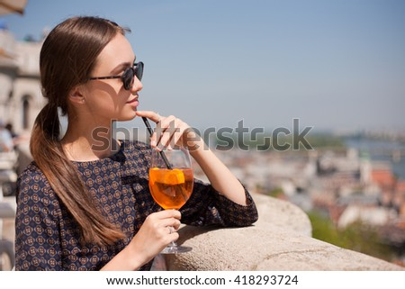 Outdoors portrait of happy young brunette tourist woman.