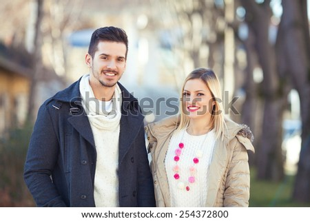 Outdoors portrait of happy young couple. - stock photo