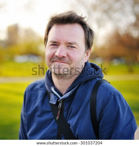 Outdoors portrait of middle age man at the spring, summer or autumn day - stock photo
