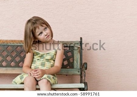 Outdoors portrait of small cute child looking to side with copy space