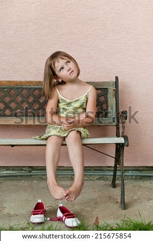 Outdoors portrait of small cute child -natural expression - stock photo