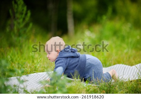 Outdoors portrait of sweet baby boy at the park - stock photo