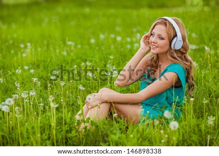 outdoors smiling portraits woman in headphones - stock photo