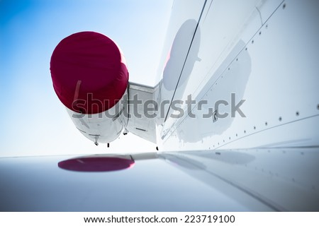 outer part of the turbine of a white plane - stock photo