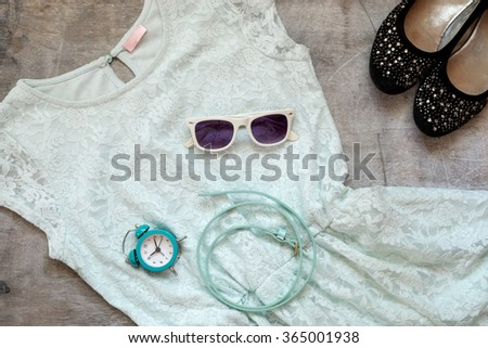 Outfit of clothes and woman accessories  on gray wooden background - stock photo