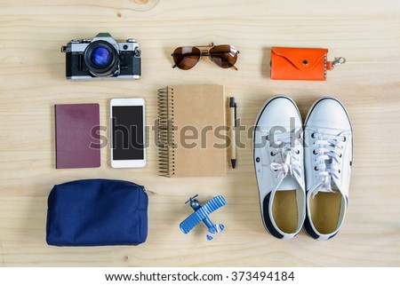 Outfit of traveler on wooden background, Travel concept - stock photo