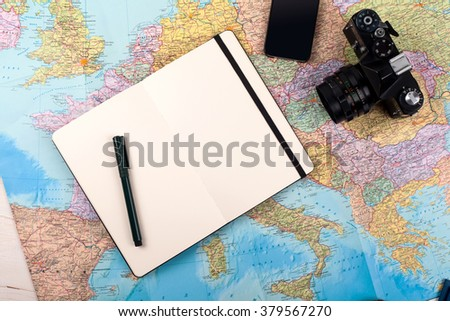 Outfit of traveler, photographer, student, teenager, young woman or guy. Different objects for planning vacation, trip or business trip on map background. - stock photo