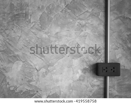 Outlet and Steel Pipe Electric Wire on Loft Style Wall Background with Copy Space, Black and White Tone, Minimalist Style - stock photo