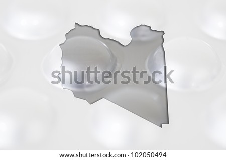 Outline libya map with transparent background of capsules symbolizing pharmacy and medicine