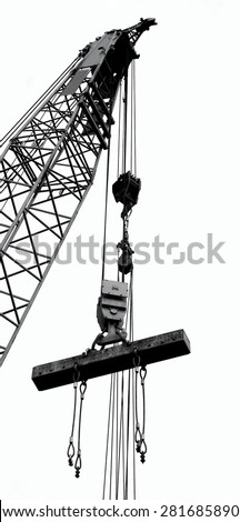 Outline silhouette of a large crane lifting a solid steel girder  - stock photo