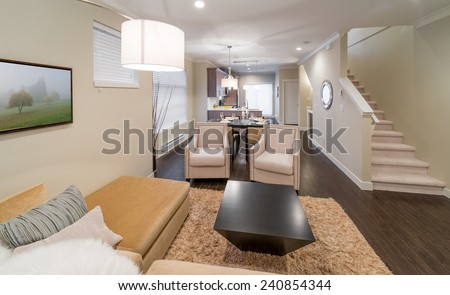 Outlook at the luxury modern living suite : two modern chairs and living room, dining room and the kitchen at the back.  Interior design. - stock photo
