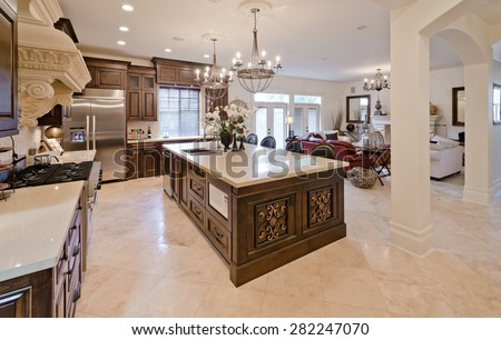 Outlook, panorama at the luxury living suite: kitchen, and living room at the back. Interior design. - stock photo