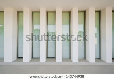 Outlook, prospect, perspective of the windows on white. Fragment of the office, building hall, lobby, doors and windows. Interior, exterior design. - stock photo